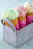Sprinkles on three ice cream cones Royalty Free Stock Images