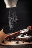 Sprinkling chocolate brownie with icing sugar and bluberry Stock Photography
