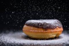 Sprinkling chocolate donut with sugar