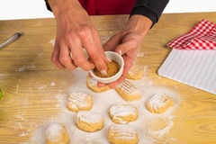 Sprinkling cinnamon on cookies Royalty Free Stock Image