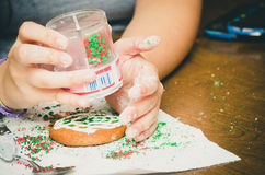 Sprinkling cookies Stock Photography