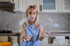 Sprinkling flour, freeze the moment. In cooking process Stock Photos