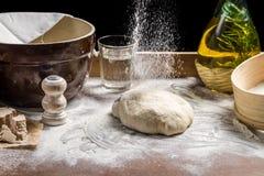 Sprinkling flour pizza dough. Closeup of sprinkling flour pizza dough Royalty Free Stock Photo