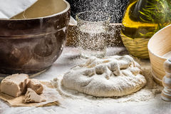 Sprinkling flour pizza dough Stock Image