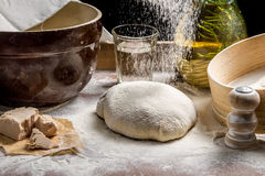 Sprinkling flour pizza dough Stock Photo