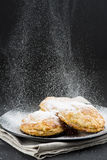 Sprinkling powdered sugar on cakes Royalty Free Stock Photo