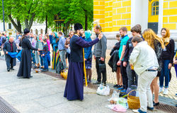 The sprinkling rite. KIEV, UKRAINE - MAY 01, 2016: The sprinkling is the most beloved rite among parishioners on Easter, on May 1, in Kiev Stock Photography