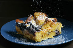 Sprinkling Sugar. Blueberry bread pudding with powdered sugar Stock Photography