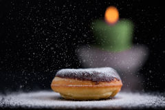 Sprinkling sugar on delicious donut Royalty Free Stock Images