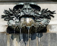 Sprinkling water of a fountain with lionhead Royalty Free Stock Photos