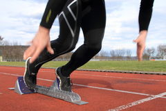 Sprint start. Athlet in sprint start in track and field Royalty Free Stock Photo