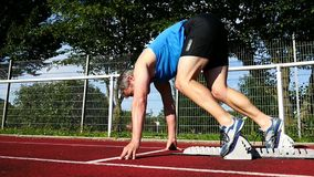 Sprint start. In track and field stock video