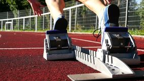 Sprint start. In track and field stock video footage