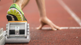 Sprint start in track and field. Feet of an athlete in sprint start in track and field Stock Photos