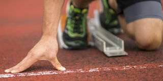 Sprint start in track and field Stock Photos