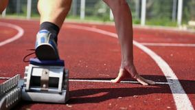 Sprint start in track and field stock video