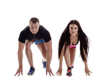Sprint. Studio photo of people on starting block Royalty Free Stock Photography
