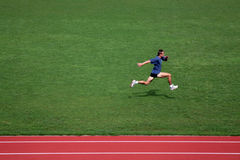 Sprint training. Man training on athletics running track Royalty Free Stock Images