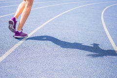Sprint of womens feet jogging outdoor by the road Stock Image