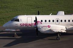 SprintAir绅宝位于停车区的340个航空器 免版税库存照片