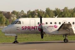 SprintAir绅宝位于停车区的340个航空器 免版税库存图片
