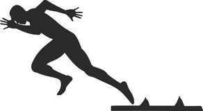 Sprinter. Silhouette of sprinter running from starting blocks Royalty Free Stock Photo