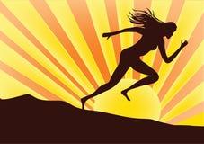 Sprinter. Woman sprinter on orange color background Stock Photo
