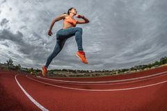 Sprinter athlete running Stock Image