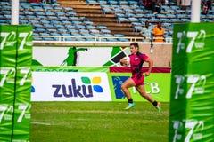 Sprinter de joueur de rugby photographie stock libre de droits
