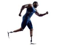 Sprinter handicappati dei corridori dell'uomo con il silhouett della protesi delle gambe Fotografia Stock