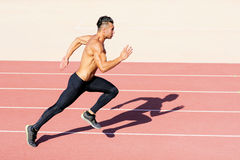 Sprinter leaving  on the running track. Royalty Free Stock Photos