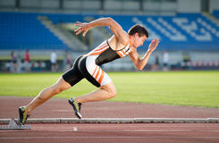 Sprinter leaving starting blocks Stock Photo