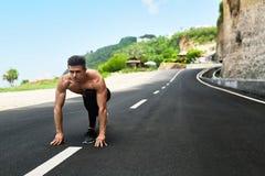 Sprinter Man On Start , Ready To Run Outdoors. Running Sports Royalty Free Stock Photos