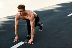 Sprinter Man On Start , Ready To Run Outdoors. Running Sports Stock Image