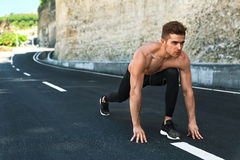 Sprinter Man On Start , Ready To Run Outdoors. Running Sports. Sports. Healthy Athletic Man With Fit Muscular Body In Starting Position For Running On Road Royalty Free Stock Photos