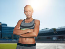 Sprinter on race track in athletics stadium Stock Image