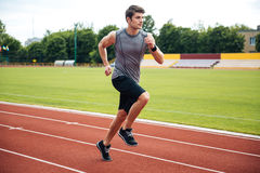 Sprinter running on athletics tracks Stock Images
