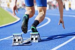 Sprinter stadium start blue tartan Royalty Free Stock Photos