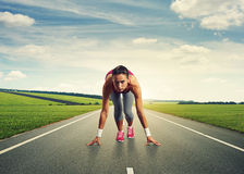 Sprinter standing on the start Royalty Free Stock Photo