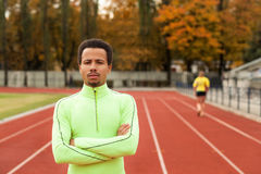 Sprinter stands in the stadium. The dark-skinned man in training Royalty Free Stock Image