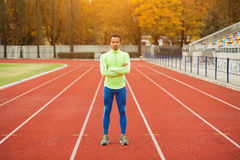 Sprinter stands in the stadium. The dark-skinned man in training Royalty Free Stock Photos