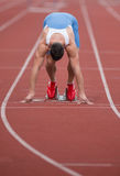 Sprinter in the starting blocks Stock Photos