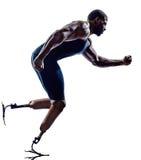 Sprinters handicapés de coureurs d'homme avec le silhouett de prothèse de jambes image libre de droits