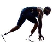 Sprinters handicapés de coureurs d'homme avec la prothèse de jambe Photographie stock libre de droits