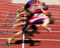 Sprinters start in blurred motion. Some sprinters in start in track and field Stock Photography