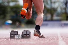 A Sprinters start in a low angle view. A sprint start in track and field in a low angle view Stock Photos