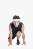 Sprinters start position. Runner is crouched and ready to sprint Royalty Free Stock Images