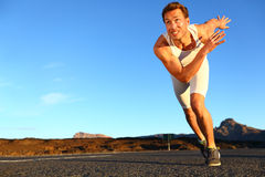 Sprinting man running. Runner sprinter at fast speed training towards goals and success. Fit muscular male athlete in workout outdoors on road Stock Image