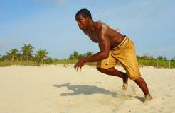 Sprinting sur la plage Images libres de droits