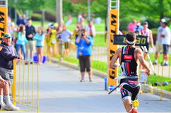Sprinting to the Finish Line. A male triathlete sprints to the finish line in the 2014 Sprint Triathlon in Pewaukee, Wisconsin royalty free stock photos